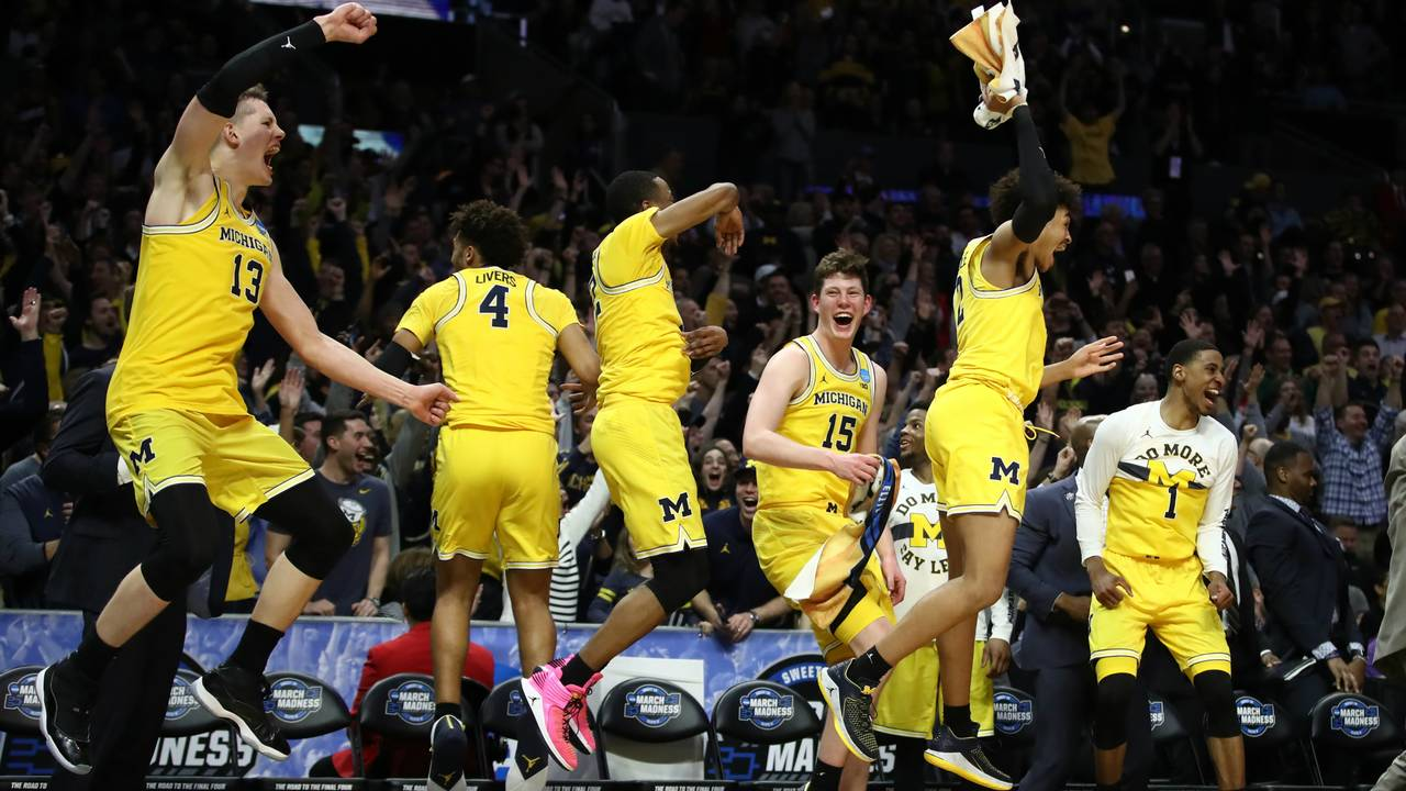 fd5654f9629 The Michigan Wolverines bench celebrates during a 27-point win over Texas  A M in the Sweet 16 of the 2018 NCAA Tournament. (Ezra Shaw Getty Images)