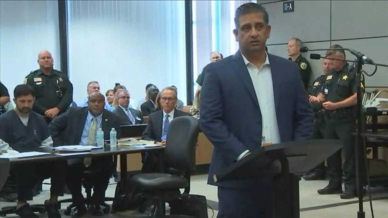 Adnan Raja testifies as brother Nouman Raja sits in background, April 25, 2019