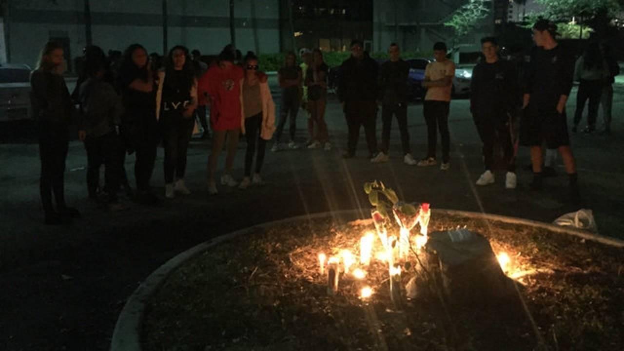 Friends gather outside LA fitness