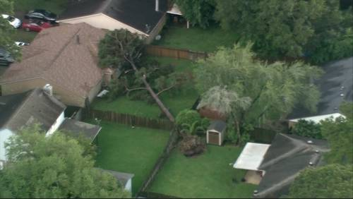 Massive tree falls onto Spring home after severe storm