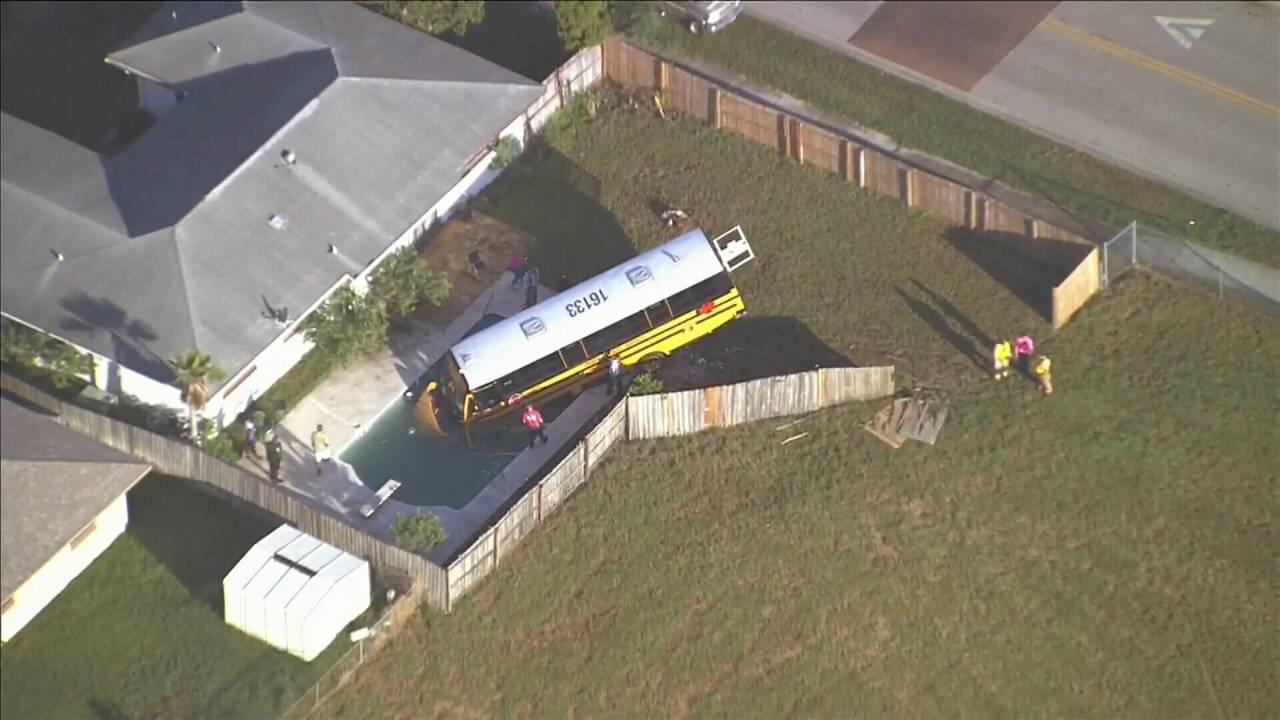 School bus in swimming pool