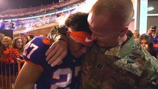 Military Dad Surprises Football Player Son Ahead of Big College Game