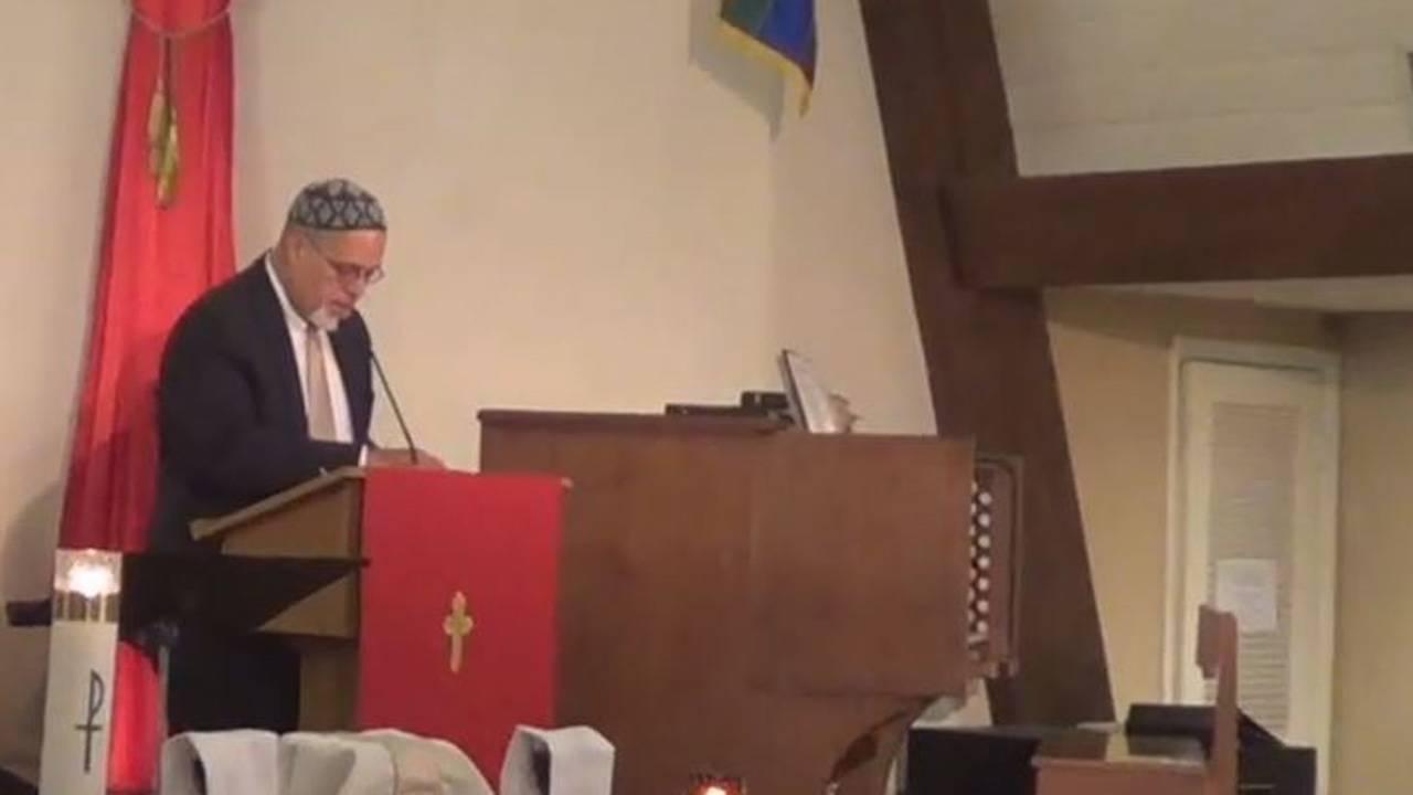 Wilfredo Ruiz speaking at church in interfaith session on Orlando