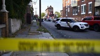 Philadelphia officers hurt in standoff