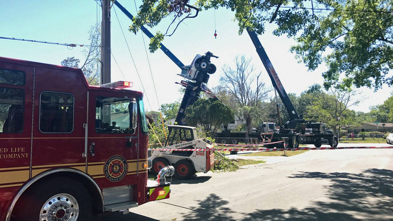 Truck tilted upright in tree removal incident