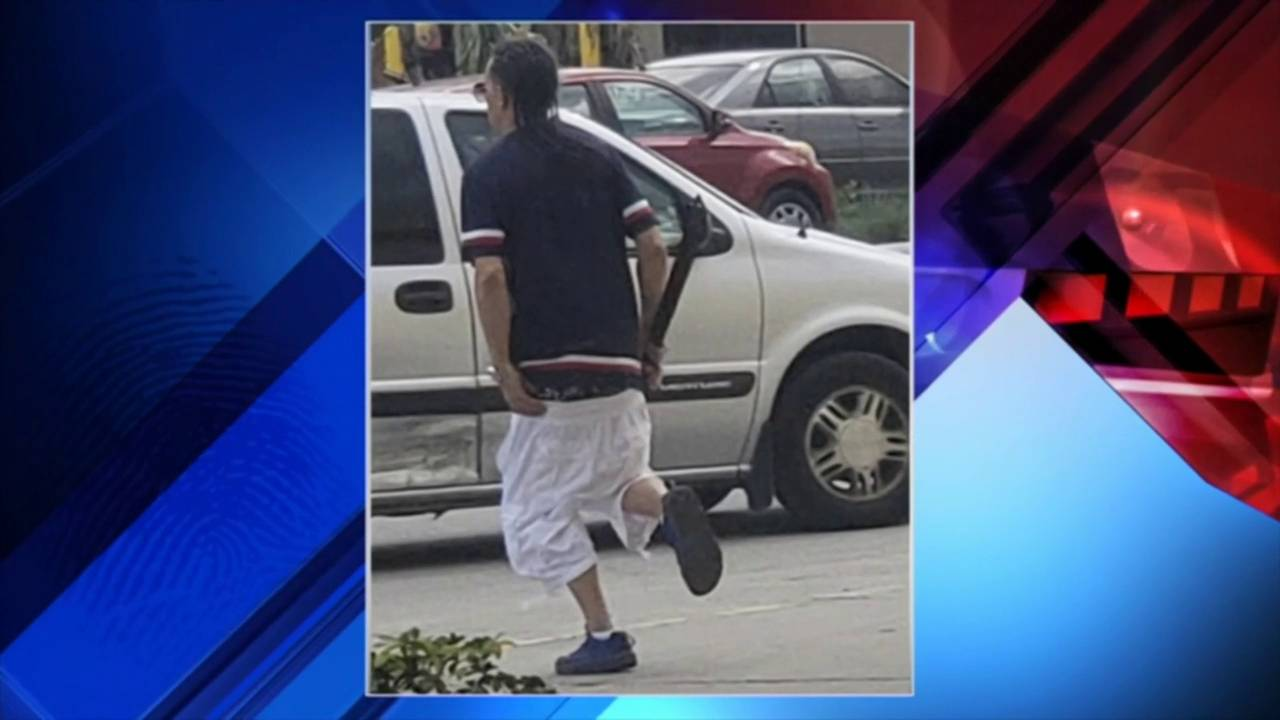 Machete-wielding robber with pants down