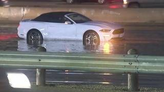 High water washes over lanes on Interstate 35, stranding drivers