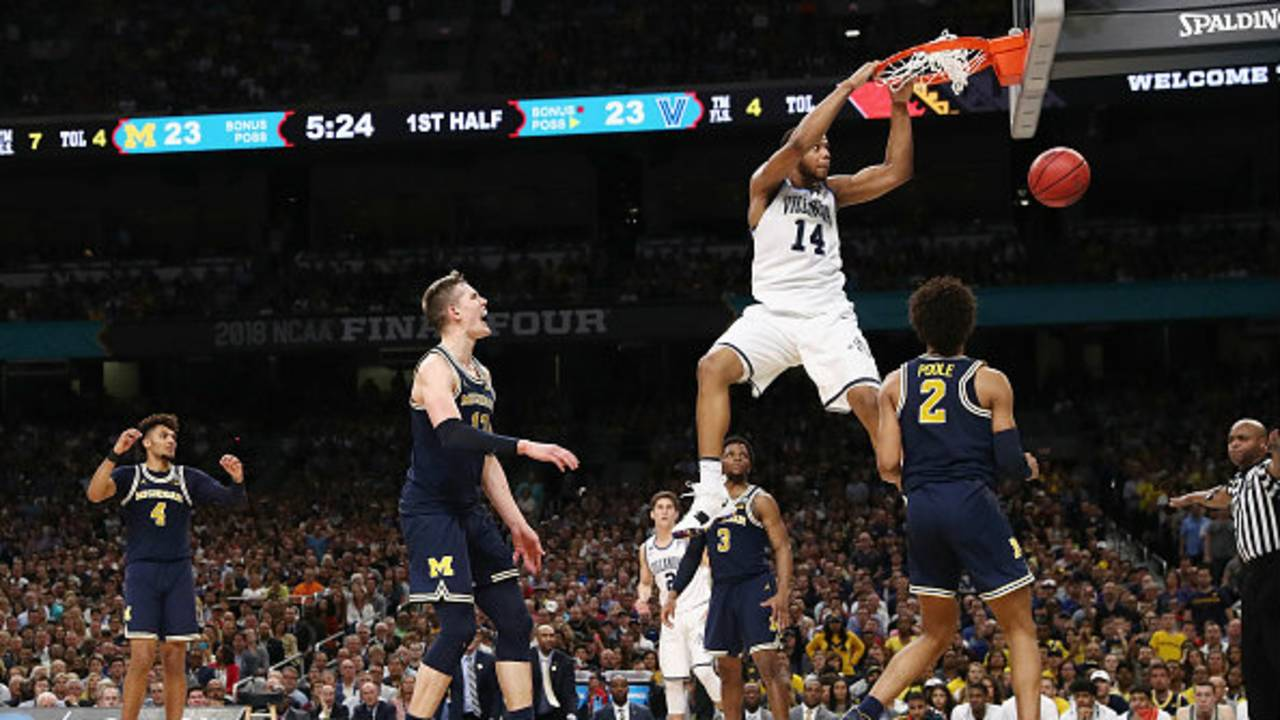 9a091e6d818 ... Spellman  14 of the Villanova Wildcats dunks in the first half against  Jordan Poole  2 of the Michigan Wolverines during the 2018 NCAA Men s Final  Four ...