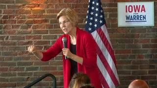 Warren unveils free college plan