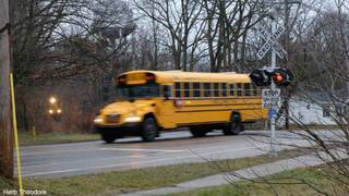 Michigan school bus driver fired after crossing tracks ahead of train