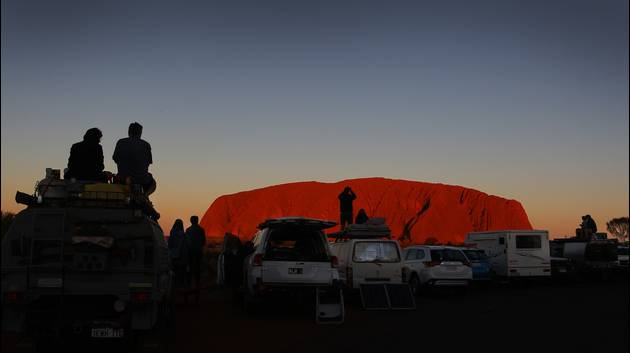Thousands flock to climb Uluru before sacred rock shuts to visitors; Jack Guy; CNN