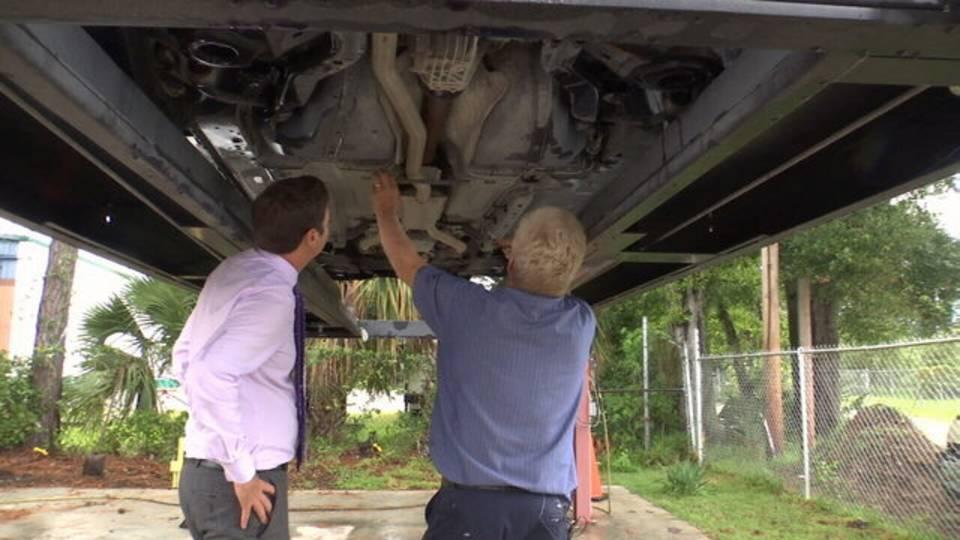 Aaron checking car_1533580982348.jpg.jpg