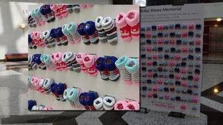 Baby shoes display offers visual reminder of infant mortality rate