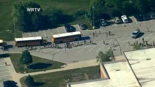 Teacher, student wounded in Indiana middle school shooting&#x3b; student in custody