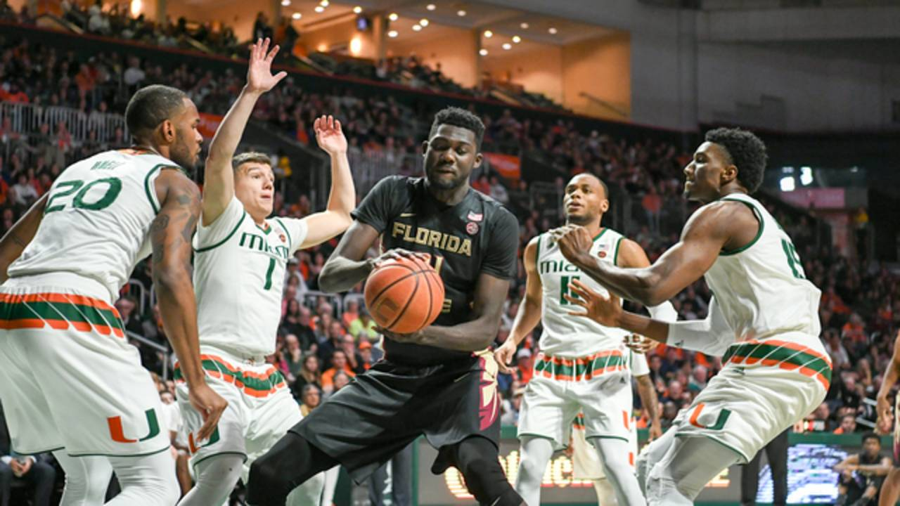Florida State Seminoles center Christ Koumadje swarmed by Miami Hurricanes players 2018