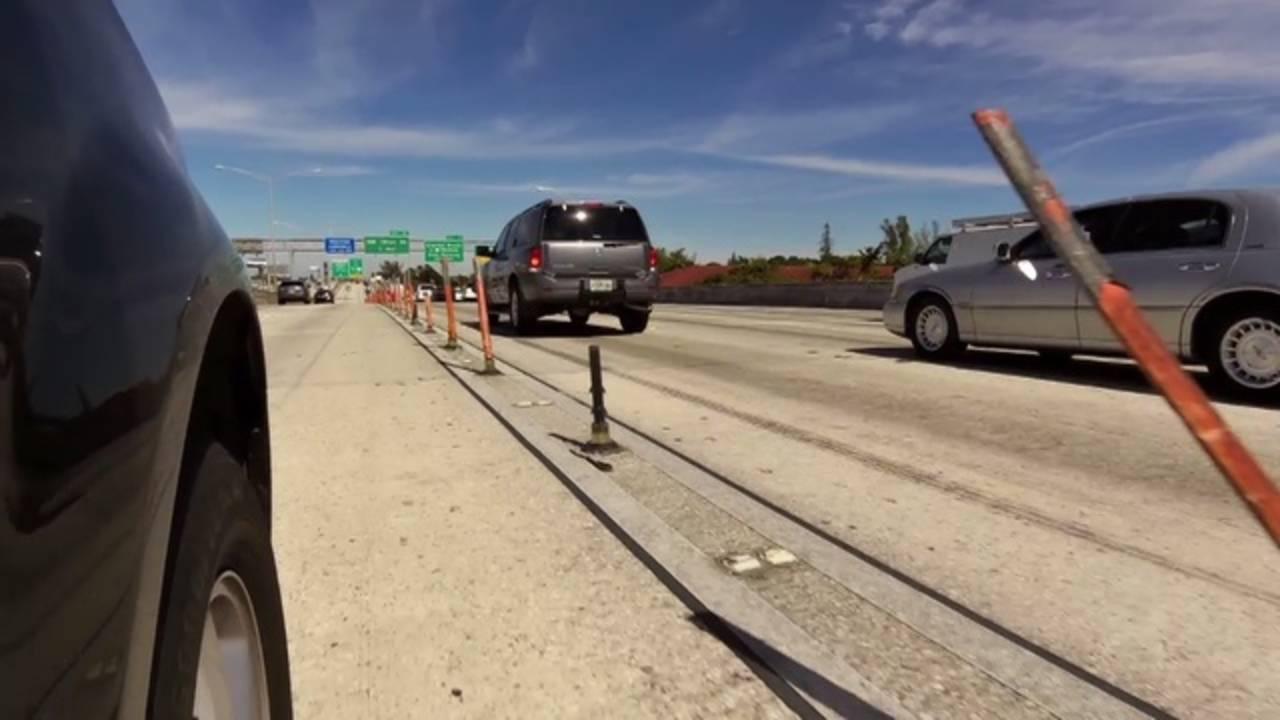 orange poles broken or bent in express lanes