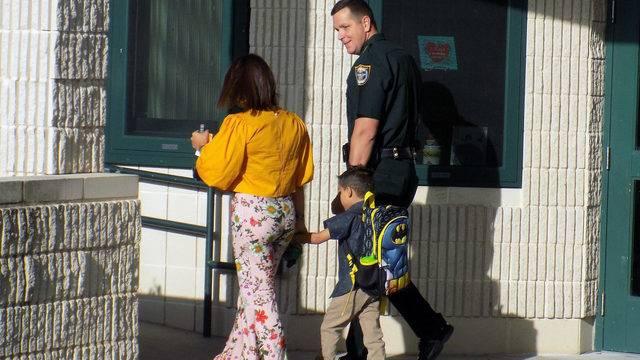 Sheriff-with-deputy-son_1533922240648.jpg