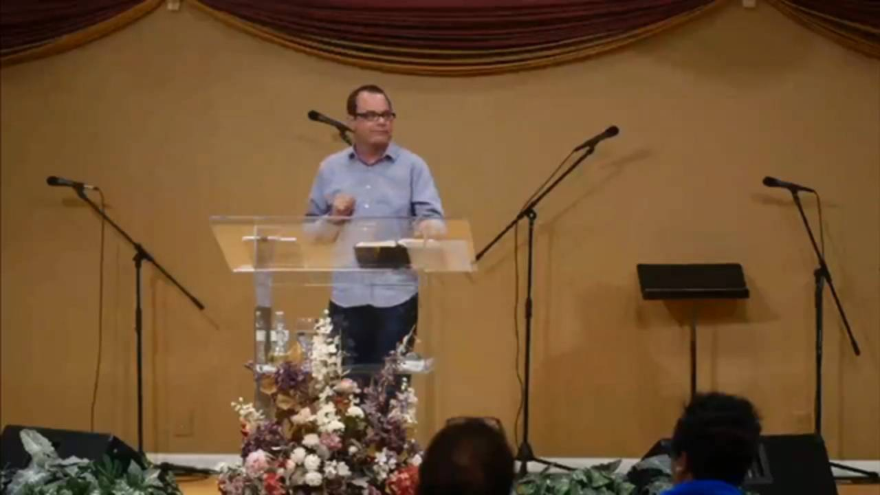 Pastor on Stage_1513282534740.jpg