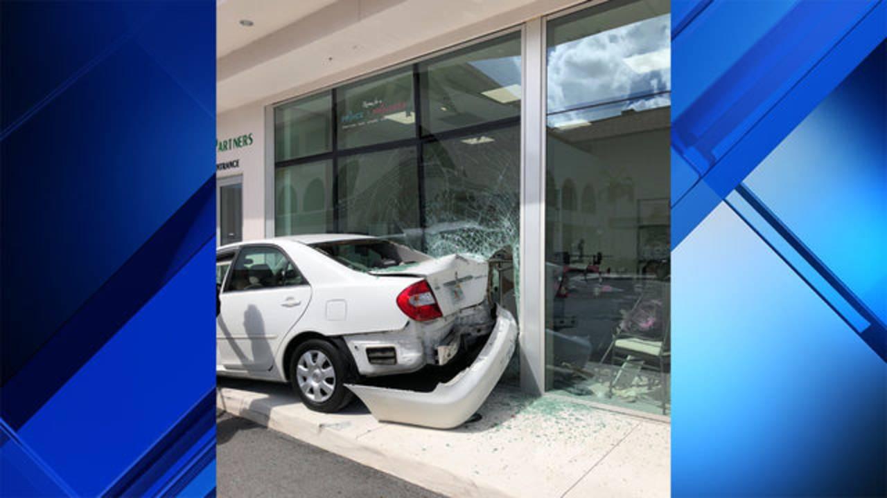 White car crashes into Boca Raton store