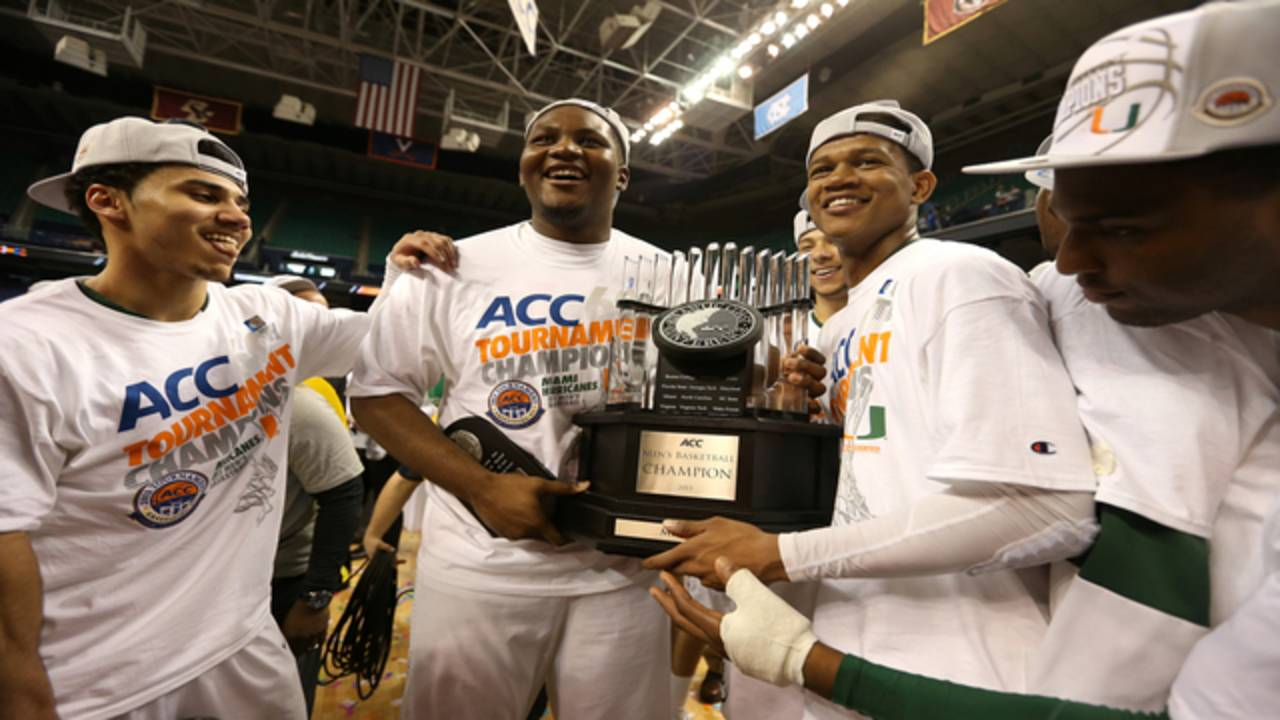 Miami Hurricanes basketball players hold 2013 ACC championship trophy