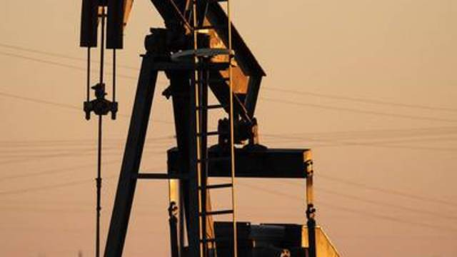 The sun sets on a pumpjack west of Andrews, Texas.