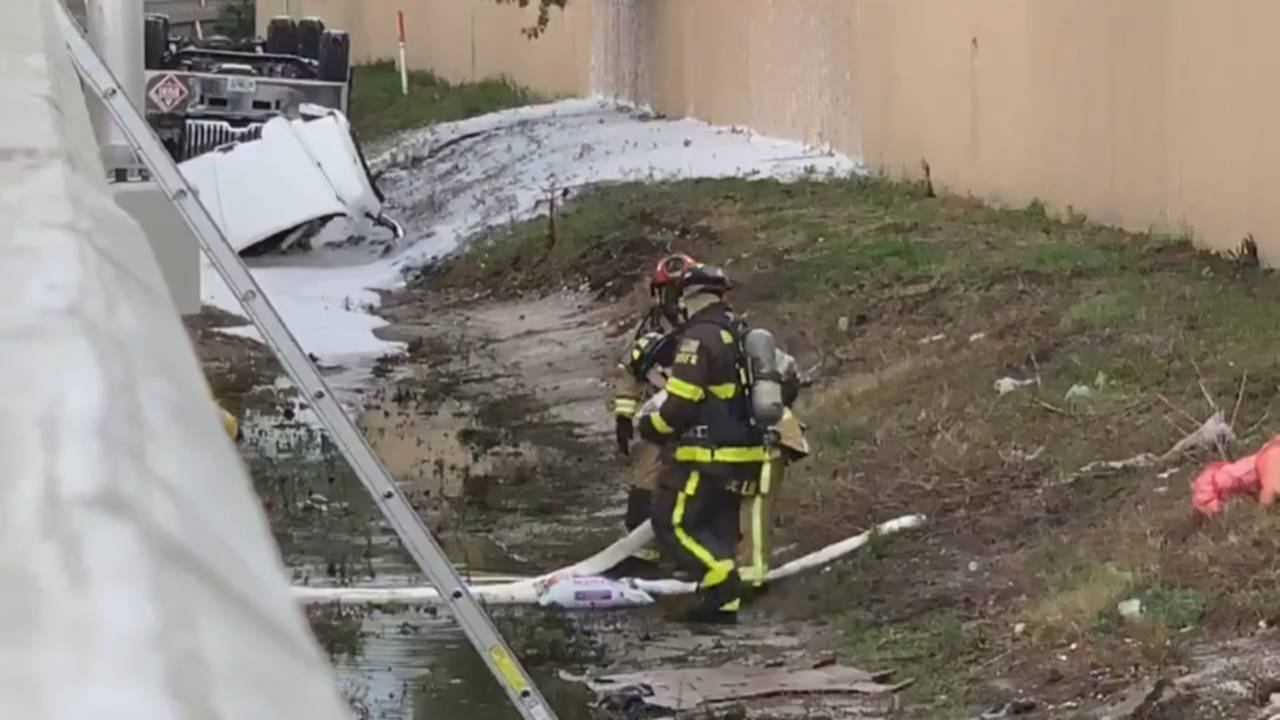 Fuel truck in grass embankment after rollover crash on I-95