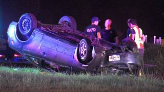 Police: Driver may face charges after rolling vehicle with 2 children inside