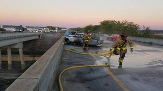 Off-duty firefighter falls off bridge while saving woman from burning car