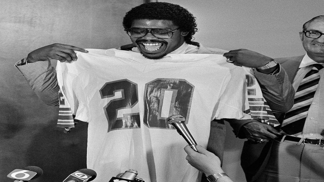 David Overstreet holds Dolphins jersey in 1983