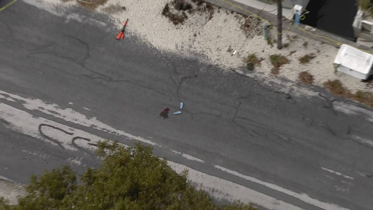 Deputy-involved shooting rifle and blood on pavement
