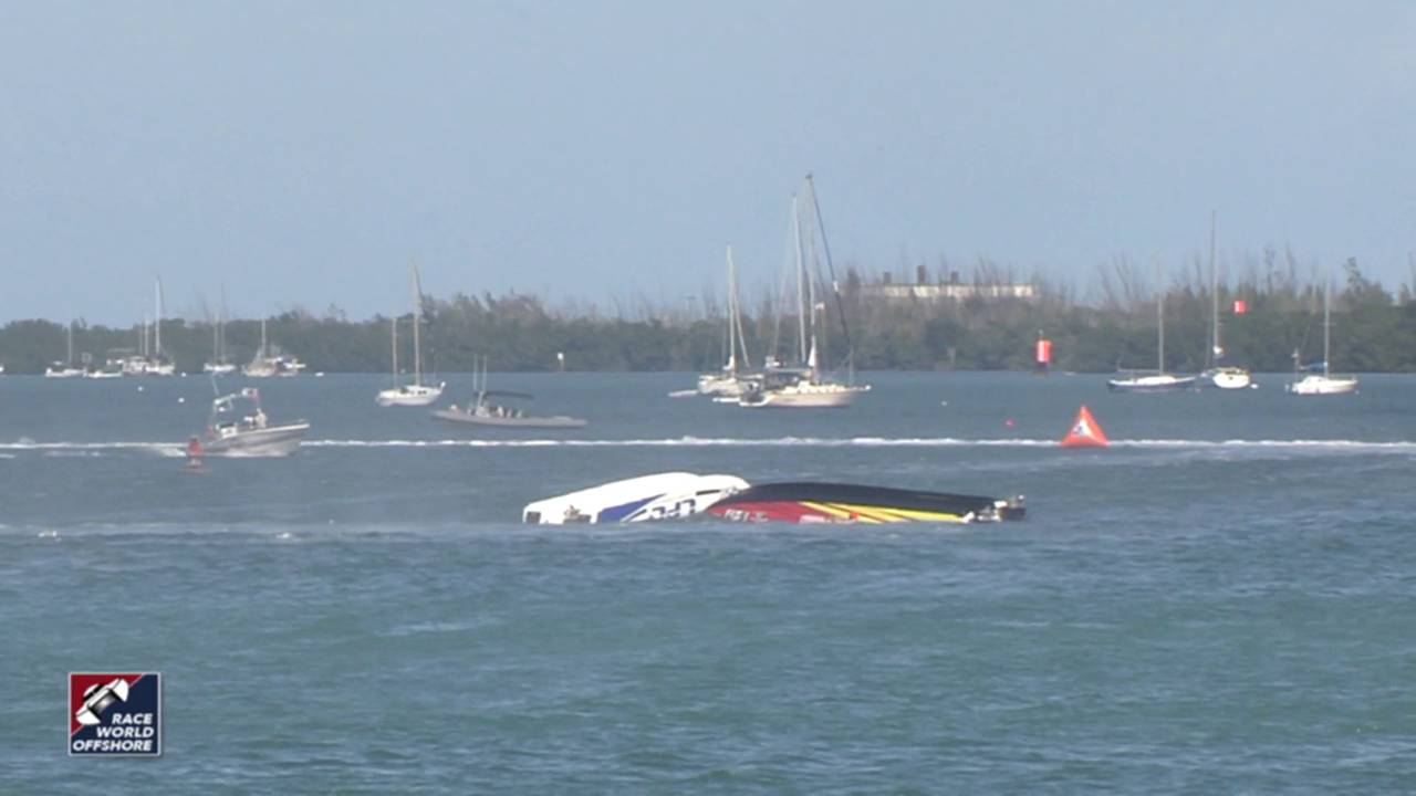 Speed boats upside-down in water after collision