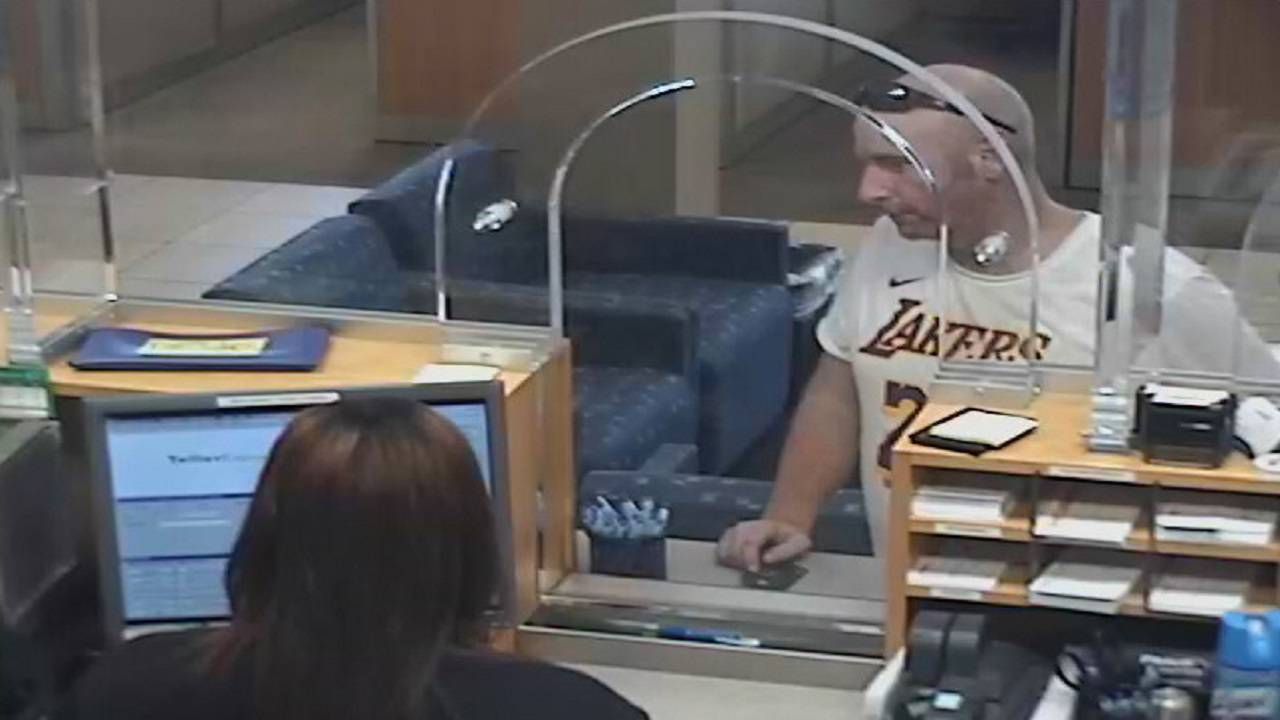 second pic of bank robber in lakers shirt