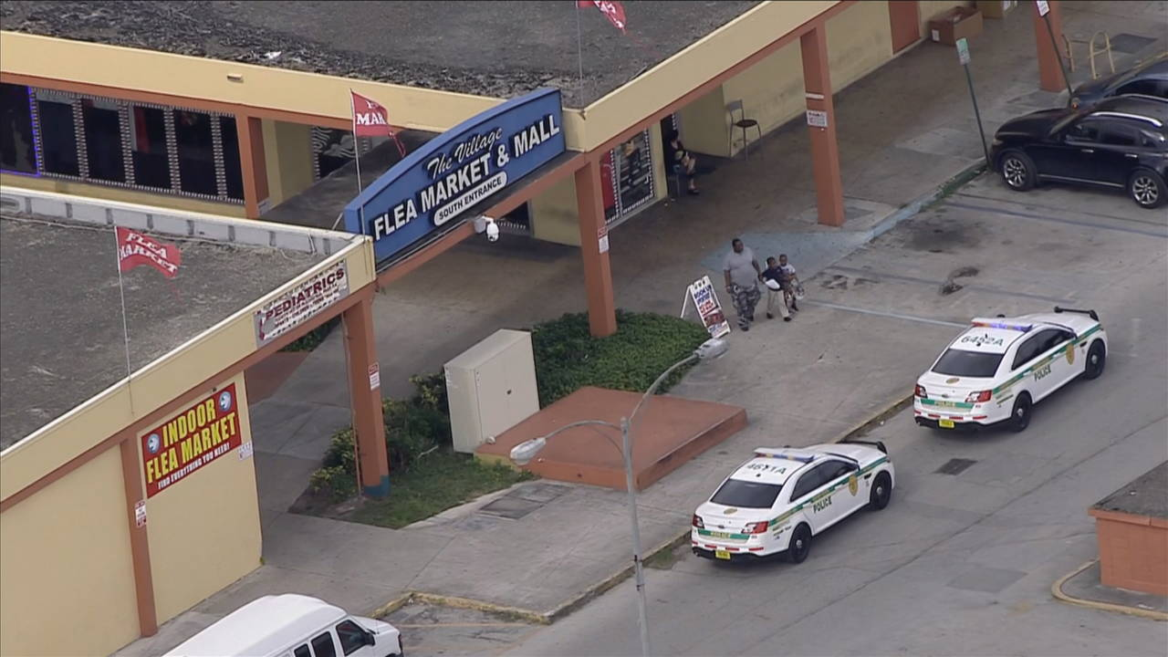 Police outside flea market after robbery