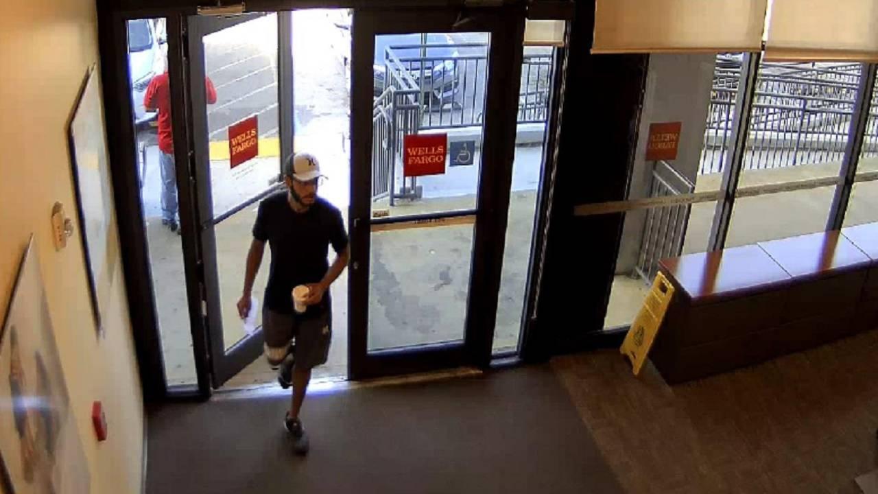 Robber entering Miami Springs bank