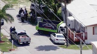 Driver injured after crashing landscaping truck into mobile home porch