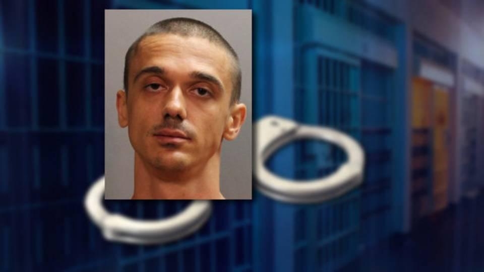 New-Javon--on-handcuffs_1533841553117.jpg
