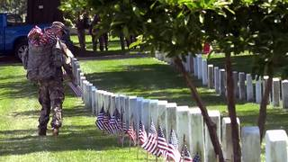 Soldiers place thousands of flags at Arlington National Cemetery