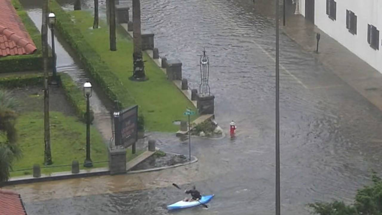 Kayaker in flooded streets of St. Augustine
