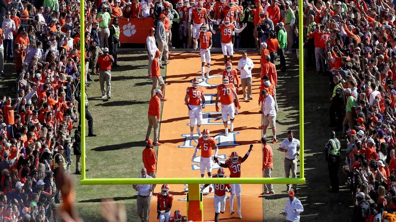 Clemson Tigers players rub Howard's Rock in 2018