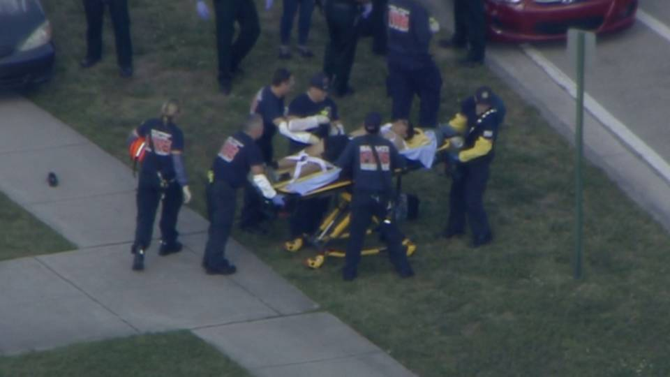 Victim on stretcher after shooting at Marjory Stoneman Douglas High School