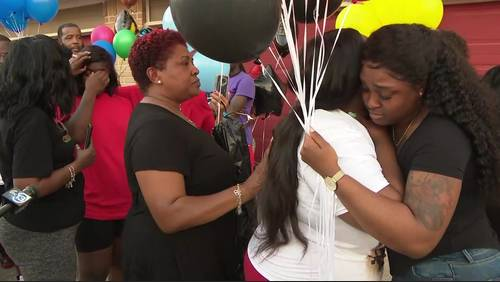 'My baby didn't deserve it': Vigil held for 2-year-old boy killed in home invasion