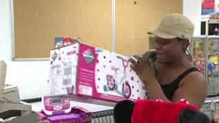 South Florida Secret Santa pays off layaway orders at Kmart stores