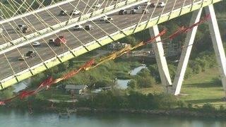PHOTOS: Greenpeace environmentalist protesters hang from Fred Hartman Bridge