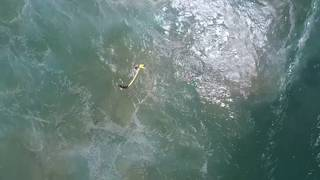Drone rescues swimmers by dropping inflatable pod