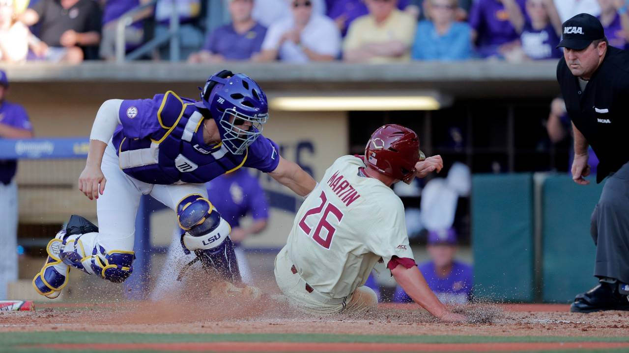 Florida State Seminoles Robby Martin scores on fielding error vs LSU Tigers
