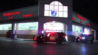 Police searching for suspect who robbed NE Side drug store at gunpoint