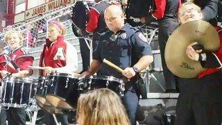 Cop Stuns Crowd When He Starts Drumming With High School Band