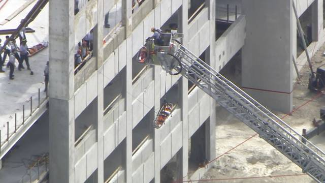 Workers lowered to ground after lift accident