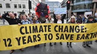 Climate protesters block access to London Stock Exchange