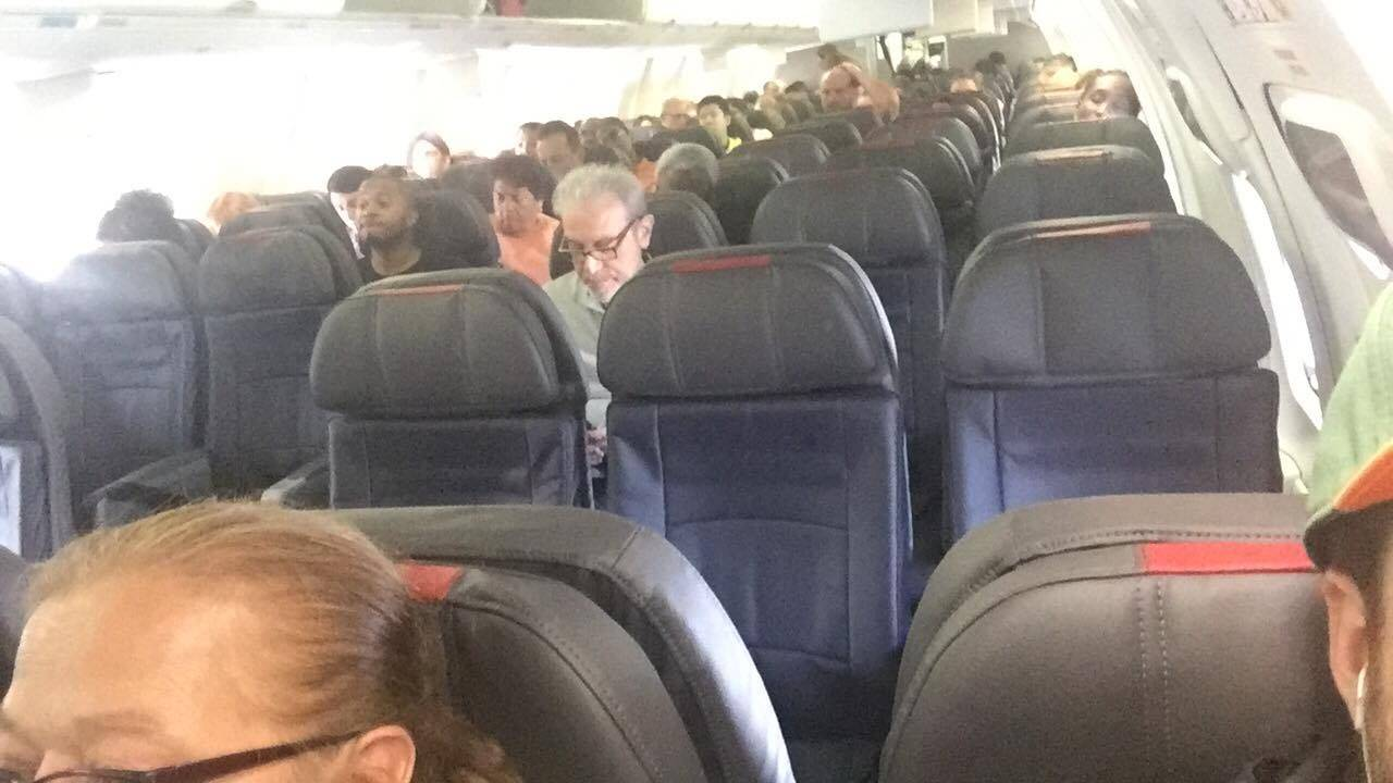 Inside plane at MIA as passengers rush to leave Miami ahead of hurricane